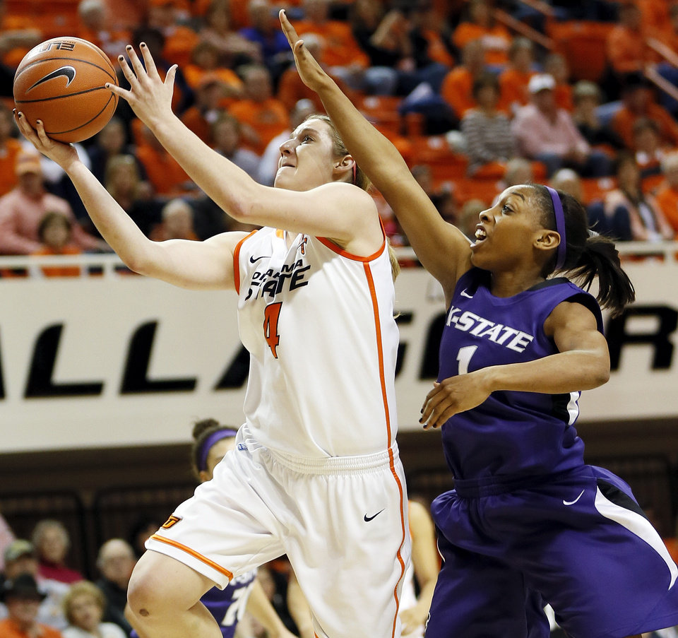 Photo - Oklahoma State's Liz Donohoe (4) takes the ball to the basket in front of Kansas State's Haley Texada (1) during an NCAA women's basketball game between Oklahoma State University (OSU) and Kansas State at Gallagher-Iba Arena in Stillwater, Okla., Saturday, Feb. 16, 2013. Photo by Nate Billings, The Oklahoman