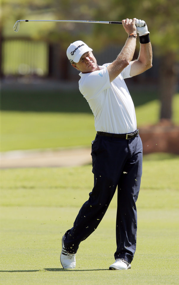 Photo - Scott Verplank hits a shot from the fairway on No. 18 during practice rounds for the U.S. Senior Open golf tournament at Oak Tree National in Edmond, Okla., Monday, July 7, 2014. Photo by Nate Billings, The Oklahoman