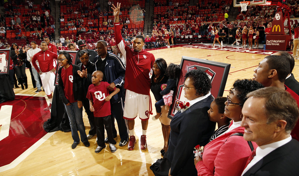 Oklahoma's Romero Osby (24) waves as he and his family are introduced before the game on Senior Day as the University of Oklahoma Sooners (OU) men play the Iowa State Cyclones in NCAA, college basketball at Lloyd Noble Center on Saturday, March 2, 2013  in Norman, Okla. Photo by Steve Sisney, The Oklahoman