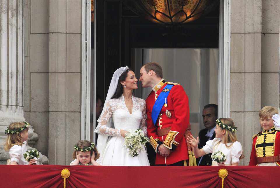 Photo - Britain's Prince William kisses his wife Kate, Duchess of Cambridge on from the balcony of Buckingham Palace after the Royal Wedding in London Friday, April, 29, 2011. (AP Photo/Matt Dunham) ORG XMIT: RWMG189