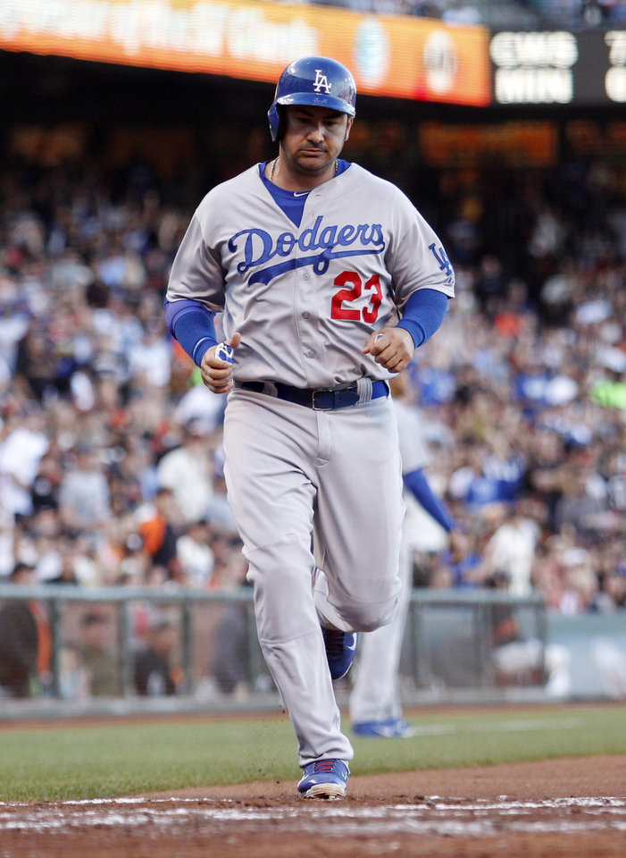 Photo - Los Angeles Dodgers' Adrian Gonzalez scores during the fourth inning of a baseball game against the San Francisco Giants, Saturday, July 26, 2014, in San Francisco. (AP Photo/Beck Diefenbach)