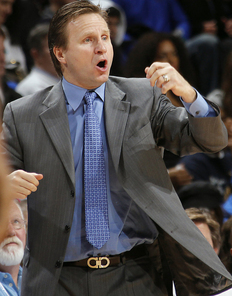Photo - Coach Scott Brooks yells at his team during the NBA basketball game between the Oklahoma City Thunder and the New Orleans Hornets at the Chesapeake Energy Arena on Wednesday, Jan. 25, 2012, in Oklahoma City, Okla. Photo by Chris Landsberger, The Oklahoman
