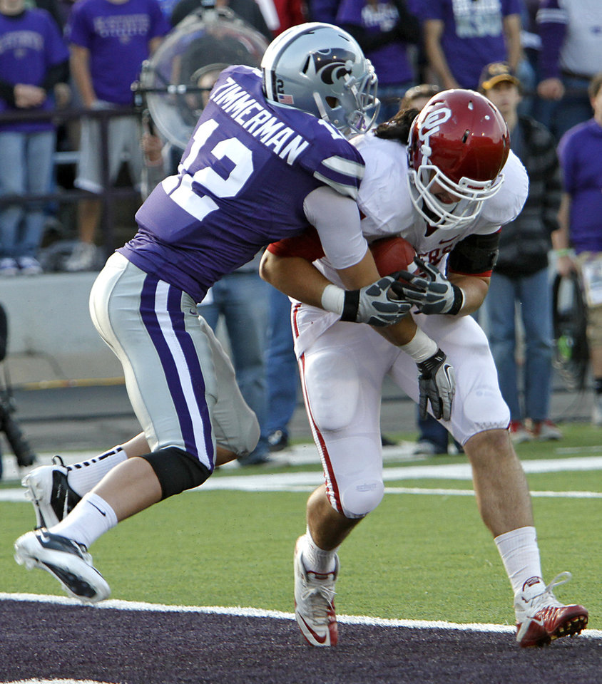 Oklahoma Sooners\' Trent Ratterree (47) scores a touchdown catch in front of Kansas State Wildcats\' Ty Zimmerman (12) during the college football game between the University of Oklahoma Sooners (OU) and the Kansas State University Wildcats (KSU) at Bill Snyder Family Stadium on Sunday, Oct. 30, 2011. in Manhattan, Kan. Photo by Chris Landsberger, The Oklahoman ORG XMIT: KOD