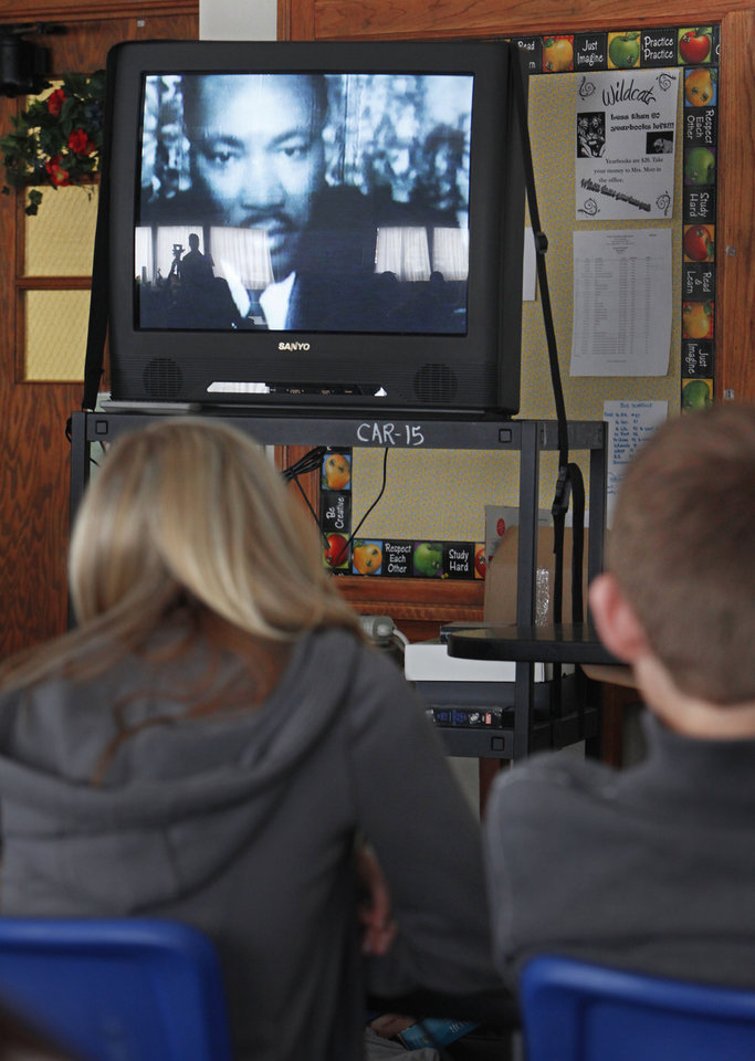 Photo - Students watch a clip on Martin Luther King Jr. in Maurisa Pruett's civil rights enrichment class at Ponca City East Middle School, Friday, February 26, 2010. Photo by David McDaniel, The Oklahoman ORG XMIT: KOD