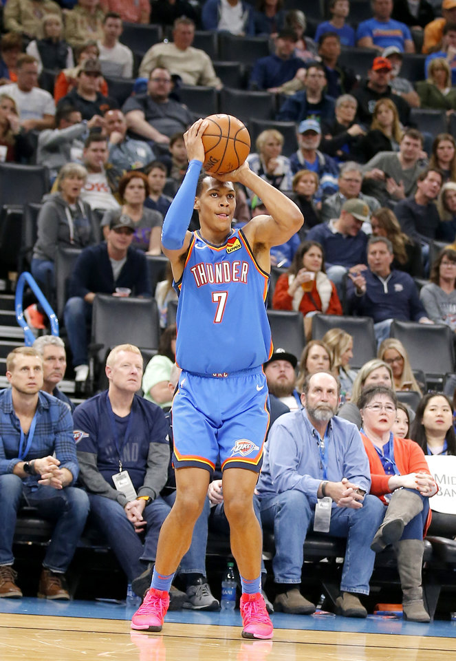 Photo - Oklahoma City's Darius Bazley (7) shoots a 3-point basket during the NBA game between the Oklahoma City Thunder and the Golden State Warriors at Chesapeake Energy Arena,   Saturday, Nov. 9, 2019.  [Sarah Phipps/The Oklahoman]