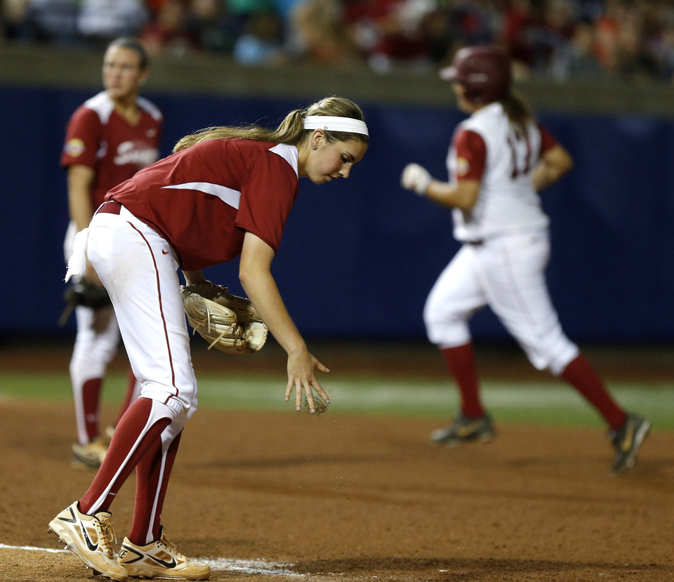 OU's Kelsey Stevens turns around after giving up a two-run home run to Alabama's Jadyn Spencer, at right, in the fifth inning of a Women's College World Series game between at ASA Hall of Fame Stadium in Oklahoma City Thursday, May 29, 2014. Photo by Bryan Terry, The Oklahoman