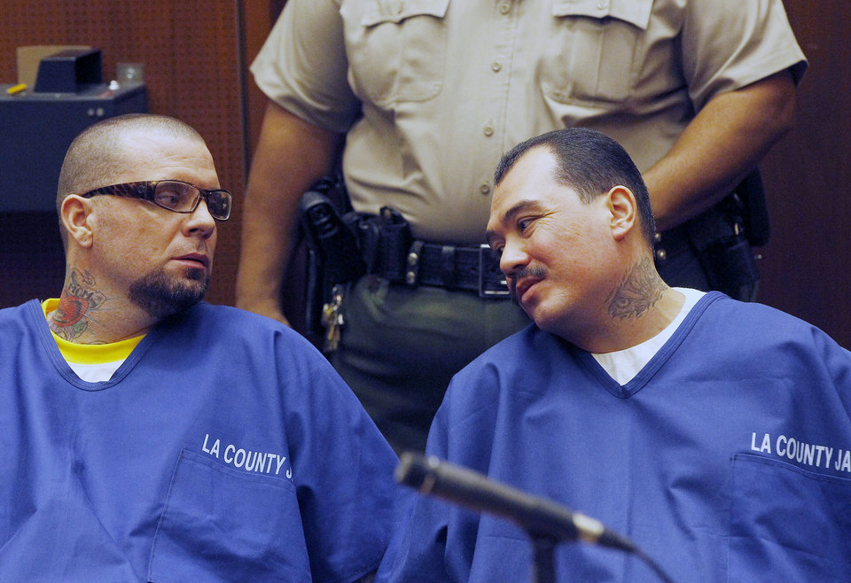 Photo - Defendants Marvin Norwood, left, and Louie Sanchez appear during a hearing Thursday Feb. 20, 2014 in Los Angeles. The two men pleaded guilty Thursday to a 2011 beating at Dodger Stadium that left San Francisco Giants fan Bryan Stow brain damaged and disabled. They were immediately sentenced by an angry judge who called them cowards and the sort of people that sports fans fear when they go to games.(AP Photo/Nick Ut )