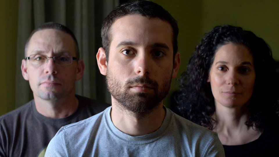 Photo - This publicity image released by the TriBeca Film Festival shows Adam Winfield, center, with his parents, Christopher, left, and Emma from