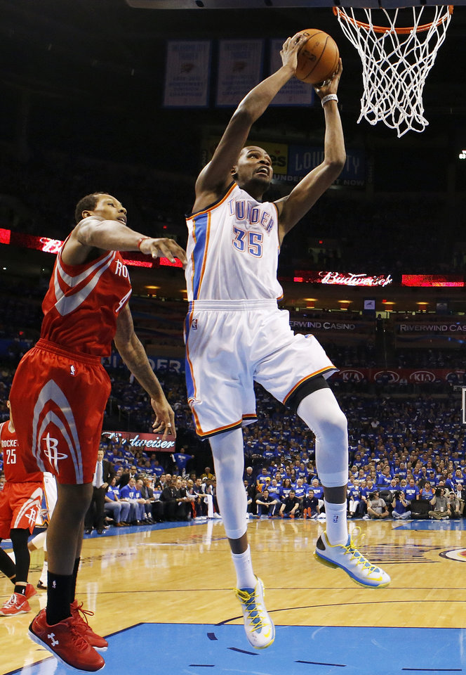 Photo - Oklahoma City's Kevin Durant (35) moves to the hoop in front of Houston's Greg Smith (4) during Game 1 in the first round of the NBA playoffs between the Oklahoma City Thunder and the Houston Rockets at Chesapeake Energy Arena in Oklahoma City, Sunday, April 21, 2013. Oklahoma City won, 120-91. Photo by Nate Billings, The Oklahoman