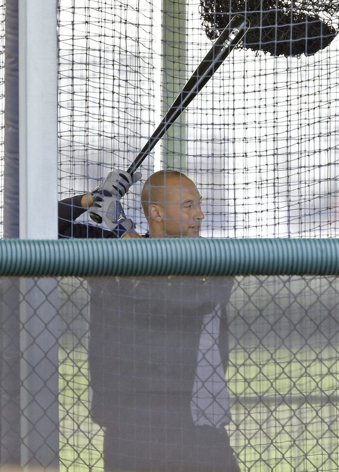 Photo - New York Yankees shortstop Derek Jeter hits in a batting cage during a workout at the baseball team's minor league facility  Thursday, Feb. 13, 2014, in Tampa, Fla. Jeter announced he will retiring at the end of the 2014 season. (AP Photo/Chris O'Meara)
