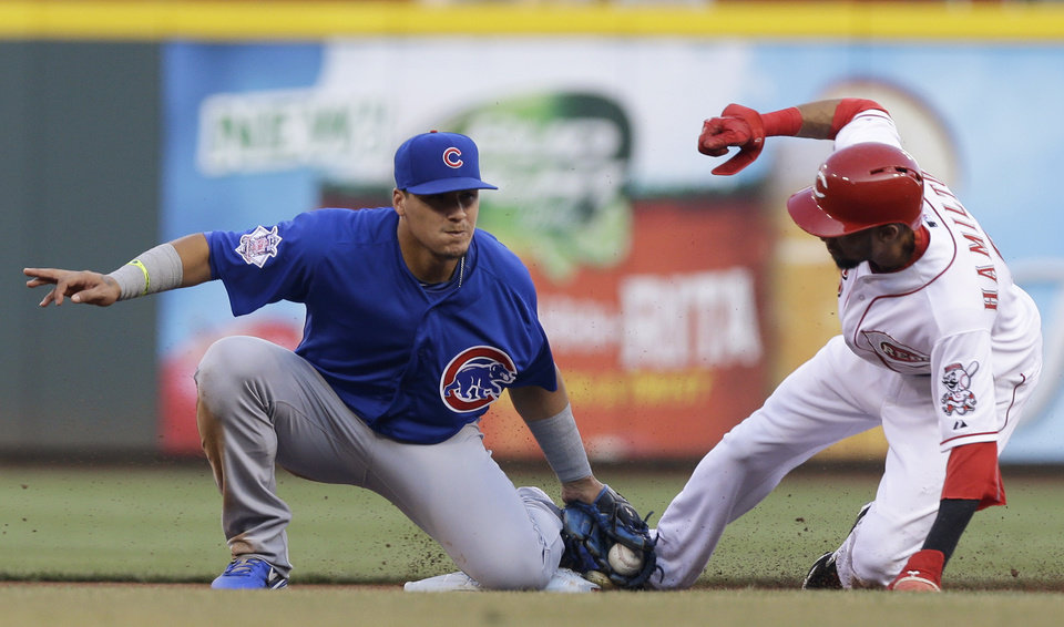 Photo - Chicago Cubs second baseman Javier Baez, left, tags out Cincinnati Reds' Billy Hamilton on an attempted steal of second base in the first inning of a baseball game, Wednesday, Aug. 27, 2014, in Cincinnati. (AP Photo/Al Behrman)