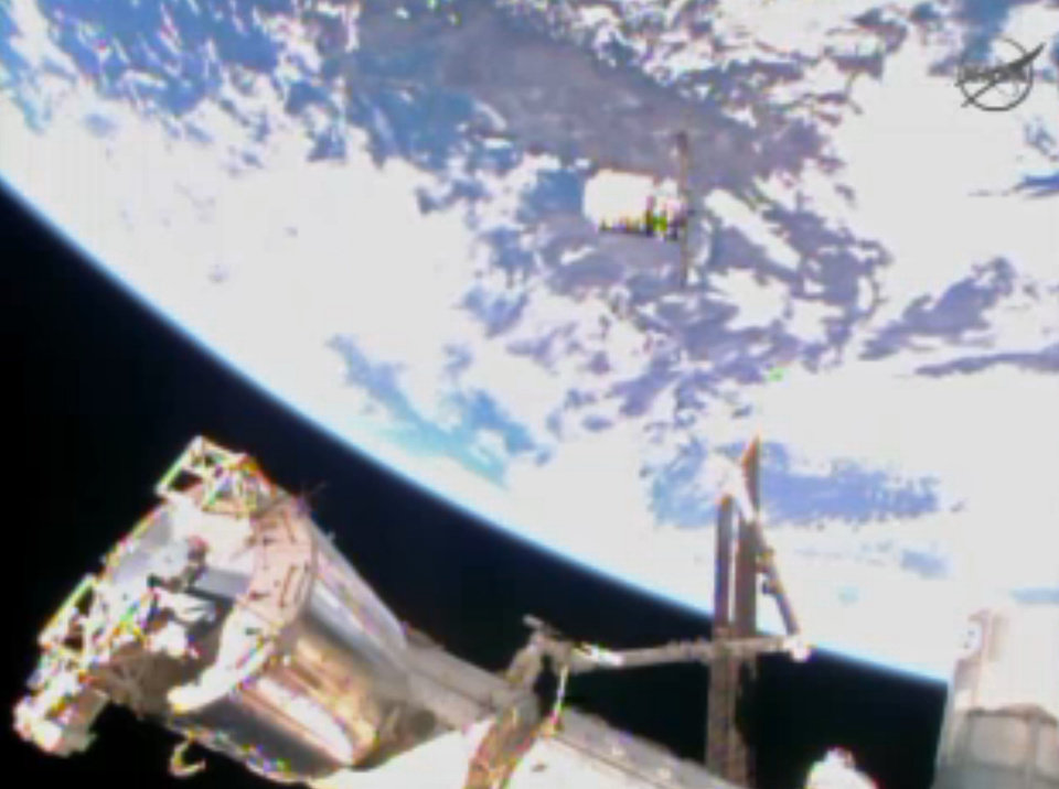 Photo - In this image from video provided by NASA the Cygnus resupply spacecraft approaches the International Space Station early Sunday Jan. 12, 2013. The spacecraft is expected to arrive on the station later this morning. It is packed with 3,000 pounds of equipment and experiments provided by NASA, as well as food and even some ants for an educational project. Christmas presents also are on board for the six space station residents; the delivery is a month late. (AP Photo/NASA)
