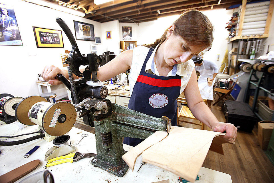 Photo - Marna Davis, from Hitchcock, cuts out a sole for a shoe Thursday in a class at Sorrell Custom Boots in Guthrie. Photo By David McDaniel, The Oklahoman