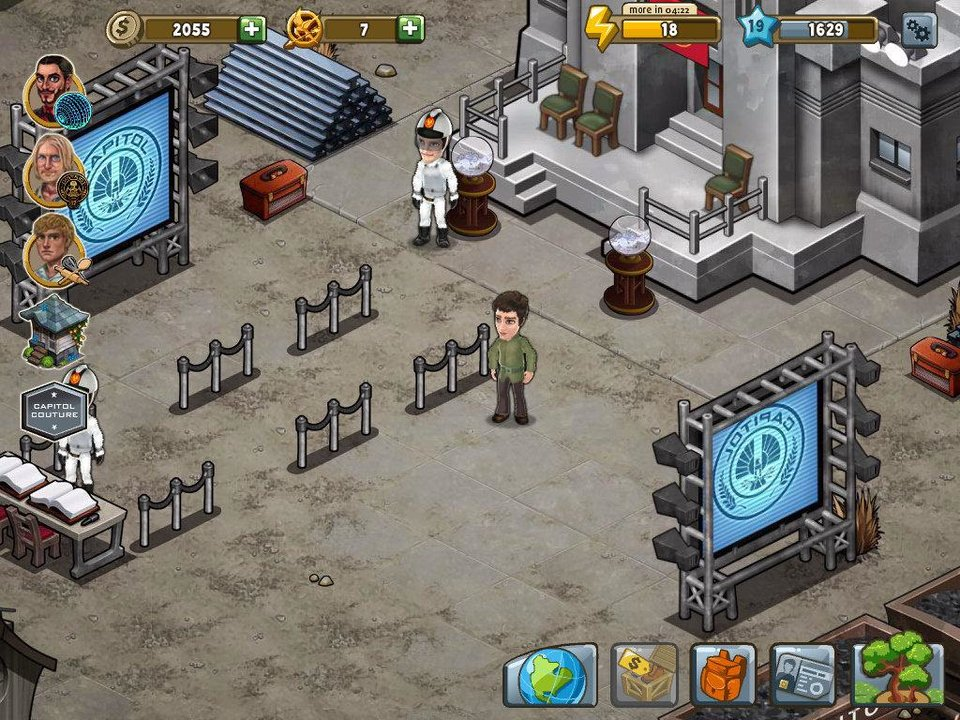 "In this screen shot from ""The Hunger Games Adventures"" mobile iPad app depicting the Justice Building, a player has to help build some things for the Capitol.    <strong></strong>"