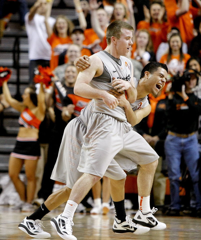 Oklahoma State's Keiton Page (12) and Cezar Guerrero (1) celebrate during an NCAA college basketball game between Oklahoma State University (OSU) and the University of Texas (UT) at Gallagher-Iba Arena in Stillwater, Okla., Saturday, Feb. 18, 2012. Oklahoma State won 90-78. Photo by Bryan Terry, The Oklahoman