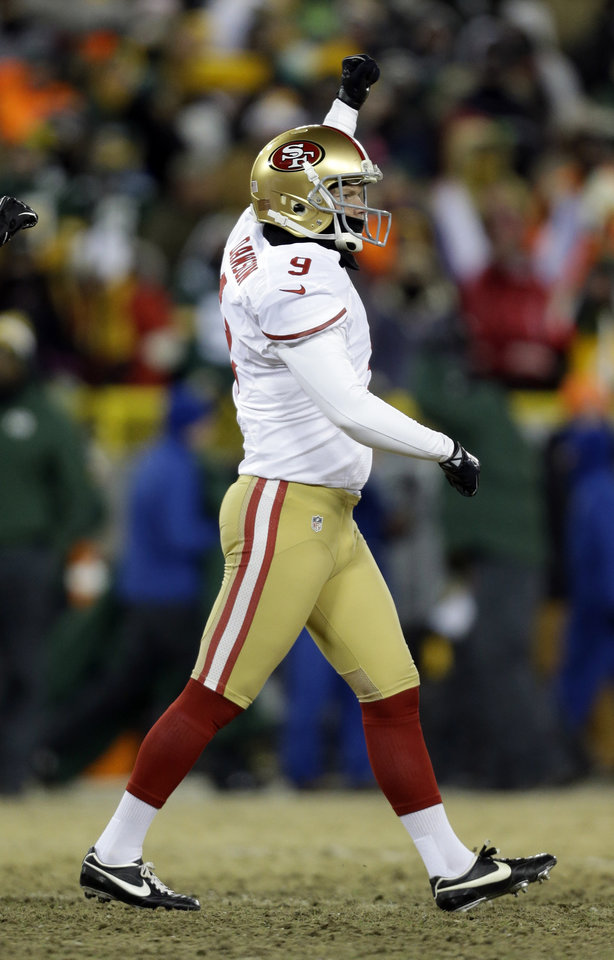 Photo - San Francisco 49ers kicker Phil Dawson (9) celebrates after kicking the game-winning field goal during the second half of an NFL wild-card playoff football game, Sunday, Jan. 5, 2014, in Green Bay, Wis. The 49ers won 23-20. (AP Photo/Jeffrey Phelps)
