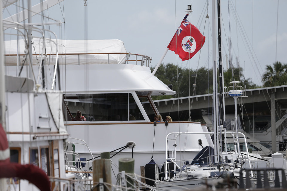 Photo -   A yacht called Cracker Bay, flying the Cayman Islands flag, sits in St Petersburg municipal marina, Wednesday, Aug. 29, 2012, in Tampa, Fla. Democrats spent part of their time trying to tarnish the Republican brand. They pointed to an ABC News report that said Mitt Romney's campaign had held a reception in Tampa Tuesday night aboard a yacht flying the flag of the Cayman Islands. Romney has been criticized for having investments there by Democrats who say the effect is to reduce his taxes.(AP Photo/Chris O'Meara)