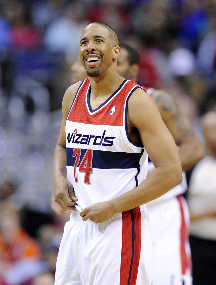 Photo - Washington Wizards guard Andre Miller (24) reacts during the first half of an NBA basketball game against the New Orleans Pelicans, Saturday, Feb. 22, 2014, in Washington. (AP Photo/Nick Wass)