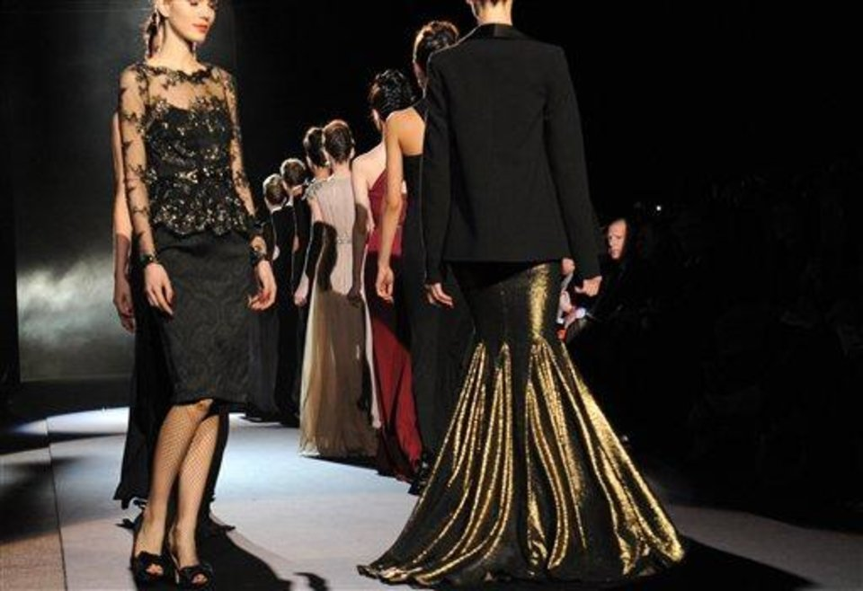 Models walk down the runway for the finale of the Badgley Mischka Fall 2013 collection during Fashion Week, Tuesday, Feb. 12, 2013, in New York. (AP Photo/Louis Lanzano)