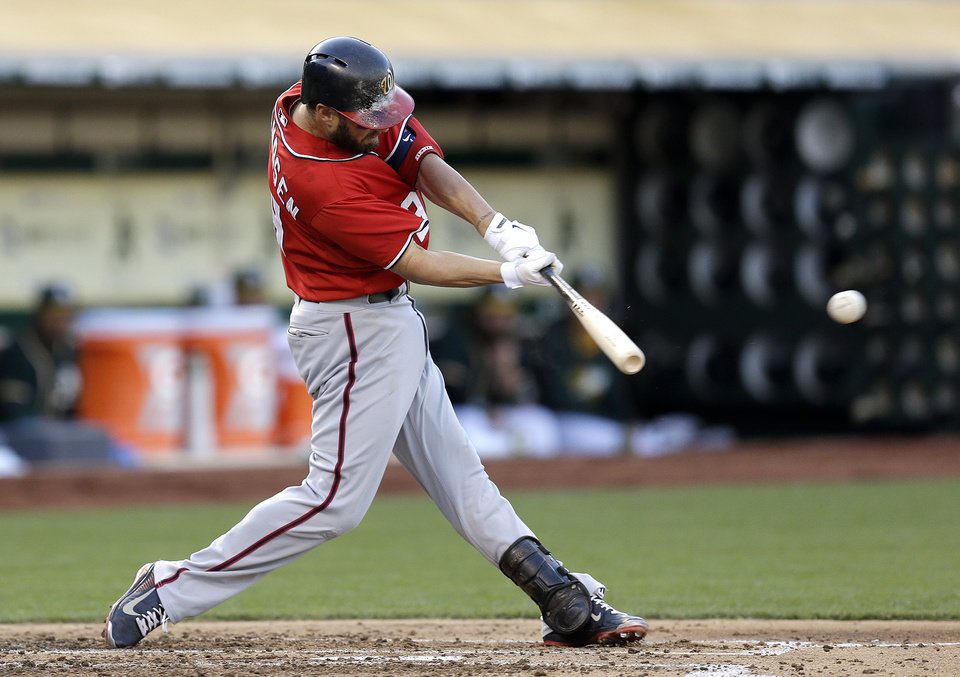 Photo - Washington Nationals' Kevin Frandsen swings for a two-run double off Oakland Athletics' Sonny Gray in the third inning of a baseball game Saturday, May 10, 2014, in Oakland, Calif. (AP Photo/Ben Margot)