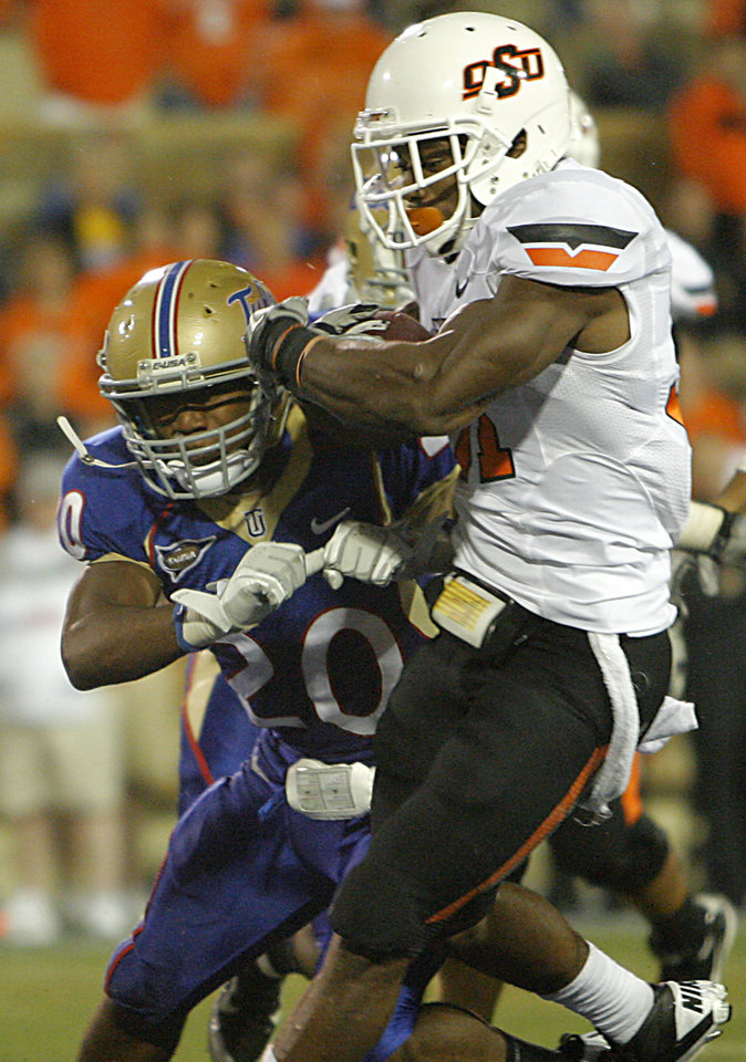 Photo - Oklahoma State's Jeremy Smith (31) is hit by Tulsa's Marco Nelson (20) as he scores a touchdown during a college football game between the Oklahoma State University Cowboys and the University of Tulsa Golden Hurricane at H.A. Chapman Stadium in Tulsa, Okla., Sunday, Sept. 18, 2011. Photo by Chris Landsberger, The Oklahoman