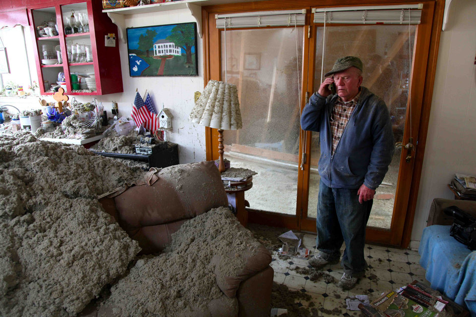 Photo -   Blaine Lawson, 76, stands inside his house after a reported tornado tore the roof off his home, Friday, March 2, 2012, in Cleveland, Tenn. Neither he nor his wife were injured. (AP Photo/Robert Ray)