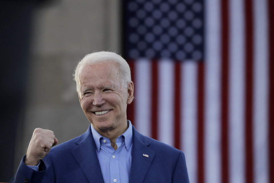 Photo - Democratic presidential candidate, former Vice President Joe Biden knowledges the crowd during a campaign rally Saturday, March 7, 2020, in Kansas City, Mo. (AP Photo/Charlie Riedel)