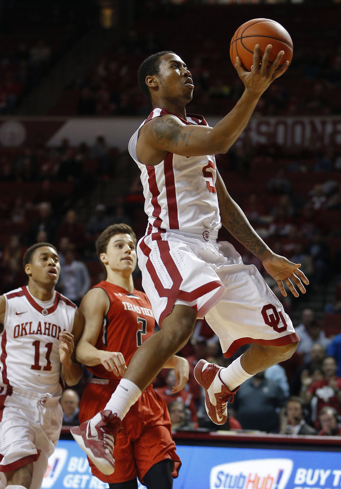 Photo - Oklahoma's Je'lon Hornbeak (5) goes to the basket in front of Texas Tech's Dusty Hannahs (2) during an NCAA college basketball game between the University of Oklahoma and Texas Tech University at the Lloyd Noble Center in Norman, Okla., Wednesday, Feb. 12, 2014. Oklahoma lost 68-60. Photo by Bryan Terry, The Oklahoman