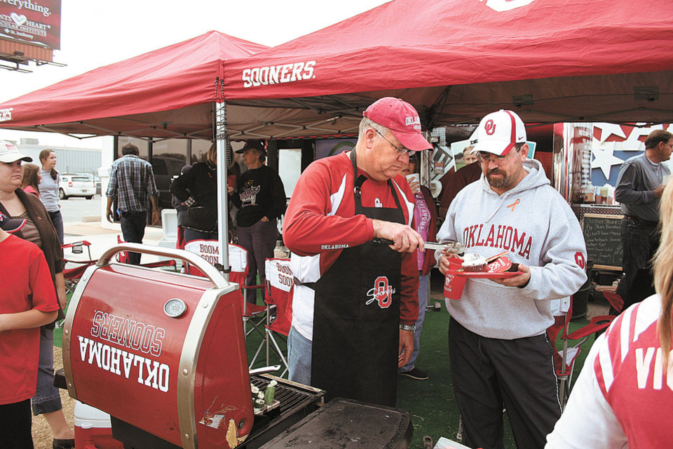 Photo - Steve Carter led the Two Docs team to the title of 2011 Bedlam Tailgating Showdown champion. PHOTO BY DAVE CATHEY, THE OKLAHOMAN  DAVE CATHEY - FOOD EDITOR