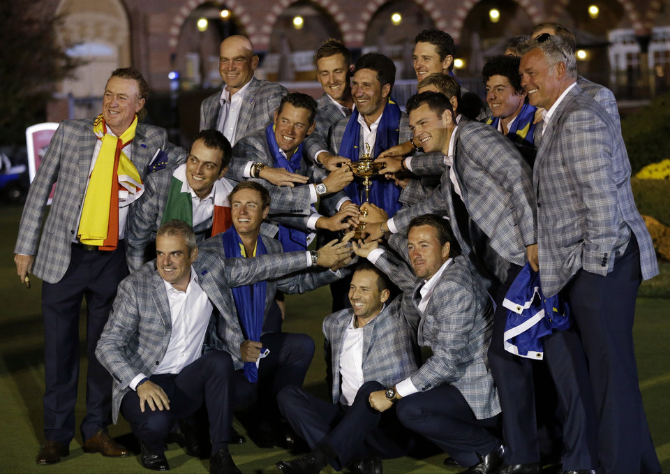 Photo - The European team posses with the trophy after winning the Ryder Cup PGA golf tournament Sunday, Sept. 30, 2012, at the Medinah Country Club in Medinah, Ill. (AP Photo/David J. Phillip)  ORG XMIT: PGA267