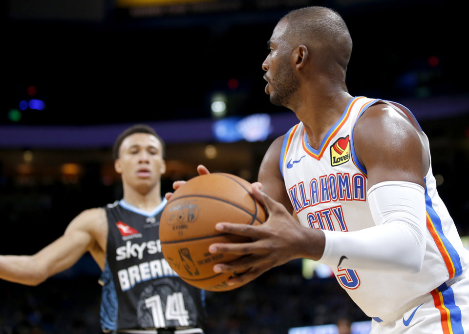 Photo - Oklahoma City's Chris Paul (3) looks to pass the ball during the NBA preseason game between the Oklahoma City Thunder and the New Zealand Breakers at the Chesapeake Energy , Thursday, Oct. 10, 2019. [Sarah Phipps/The Oklahoman]