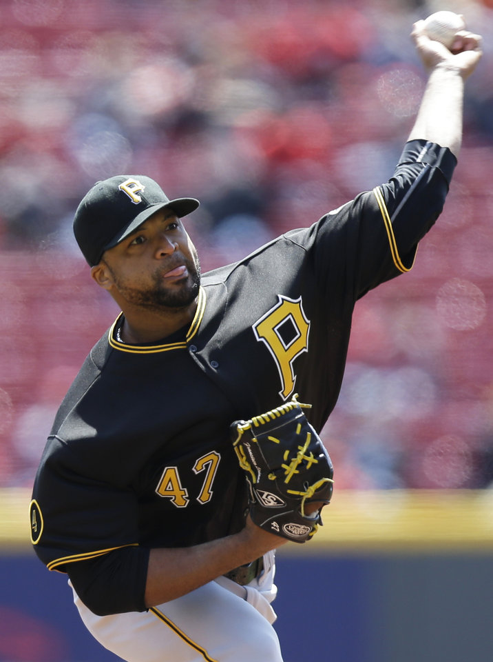 Photo - Pittsburgh Pirates starting pitcher Francisco Liriano throws against the Cincinnati Reds in the first inning of a baseball game, Wednesday, April 16, 2014, in Cincinnati. (AP Photo/Al Behrman)