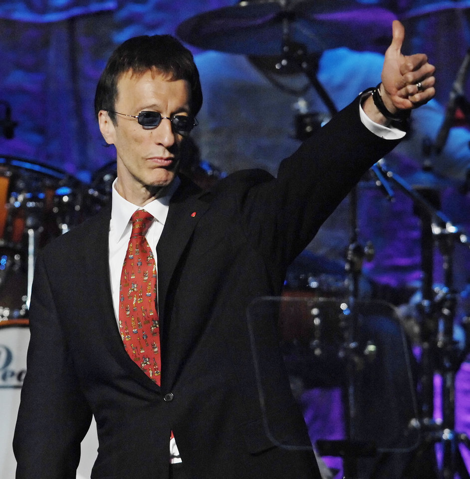 Photo -   FILE - In this May 15, 2007, file photo, The Bee Gees' Robin Gibb salutes the crowd after The Bee Gees were named BMI Icons during the 55th Annual BMI Pop Awards in Beverly Hills, Calif. A representative said on Sunday, May 20, 2012, that Gibb has died at the age of 62. (AP Photo/Chris Pizzello, File)
