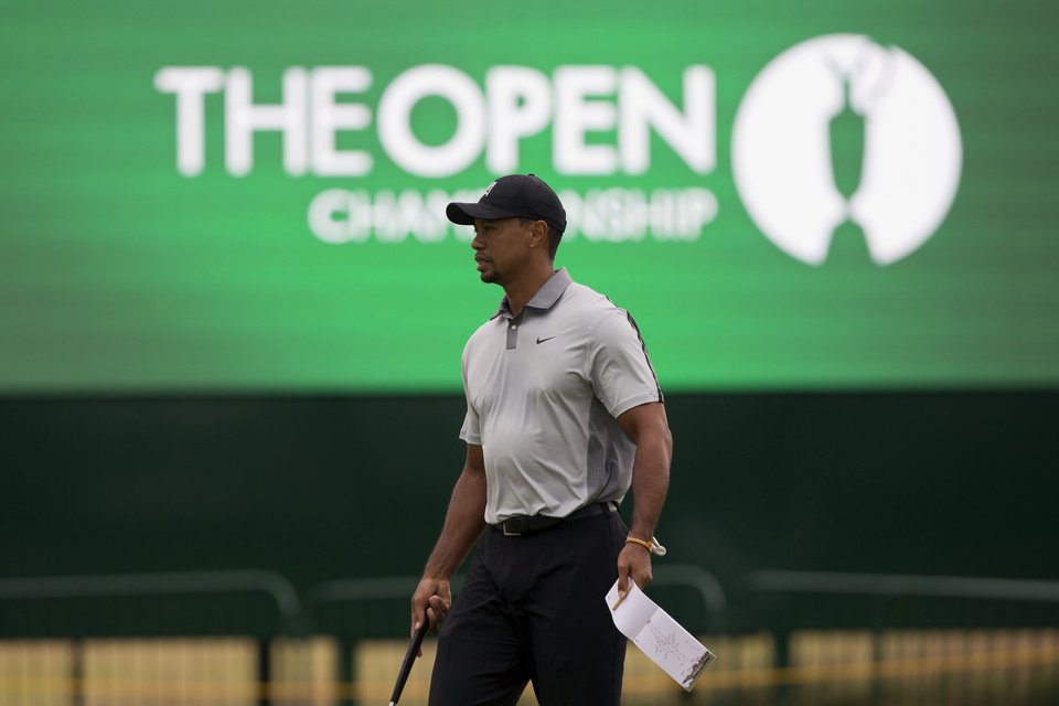 Photo - Tiger Woods of the US walks on the 2nd green during a practice round at the Royal Liverpool Golf Club prior to the start of the British Open Golf Championship, in Hoylake, England, Saturday, July 12, 2014. The 2014 Open Championship starts on Thursday, July 17. (AP Photo/Jon Super)