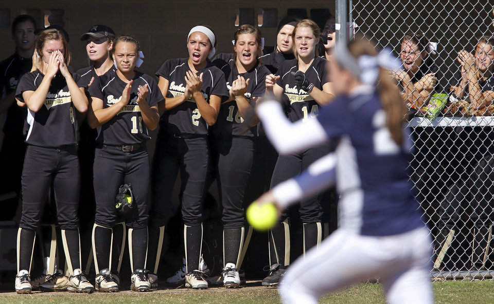Photo - Broken Arrow players cheer for one of their batters from inside the dugout during their game against Edmond North at the Class 6A high school fast-pitch softball championship tournament at the Ball Fields at Firelake in Shawnee on Thursday, Oct. 17, 2013.   Photo by Jim Beckel,  The Oklahoman.