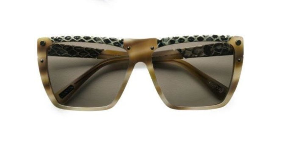 For those who follow the Chinese zodiac, the year of the snake begins Feb. 10. Some ways to incorporate the symbol of the year into your wardrobe, with no harm done to any living creature include these Lanvin snake-print leather accented modified square sunglasses, $475 from Saksfifthavenue.com. (Saksfifthavenue.com via Los Angeles Times/MCT)