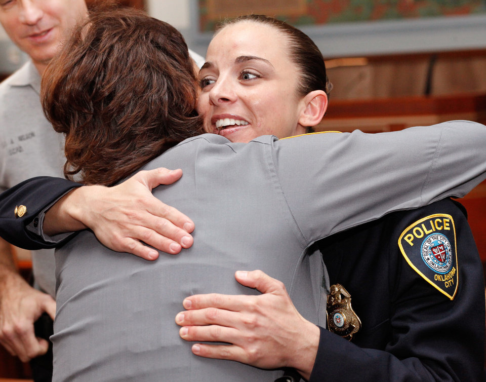 Officer Katie Lawson hugs another officer as she is greeted by the nearly 40 fellow officers who remained in the courtroom after her shooters were sentenced. Brothers Alex Mercado and Hector Escalante were given separate sentences by District Judge Donald Deason in an Oklahoma County courtroom Tuesday afternoon, Nov. 8, 2011 for their involvement in shooting Oklahoma City police officer Katie Lawson during an ambush in south Oklahoma City in Aug, 2010. Chief Bill Citty and his four assistant chiefs were seated among nearly 40 uniformed police officers in the courtroom as the sentences were imposed. Several said they came to support Officer Lawson. Photo by Jim Beckel, The Oklahoman