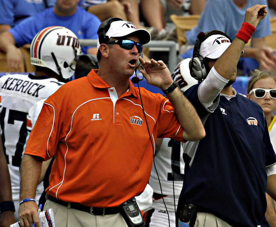 Photo - Tennessee-Martin coach Jason Simpson shouts instructions to his team in their NCAA college football game against Kentucky in Lexington, Ky., Saturday, Aug. 30, 2014.Kentucky beat Tennessee-Martin 59-14. (AP Photo/Garry Jones)