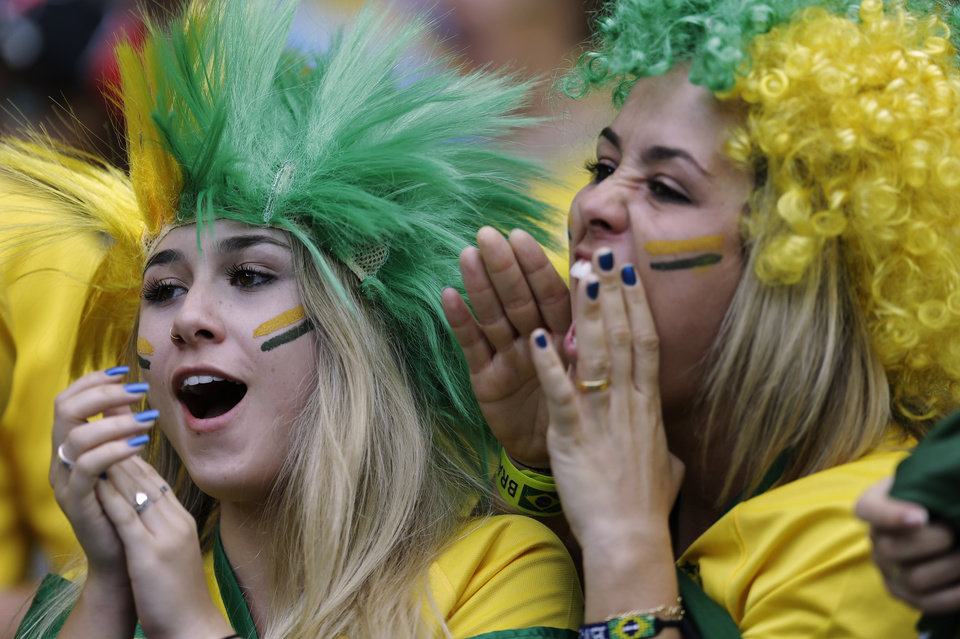Photo - Brazil supporters cheer for their national team before the World Cup semifinal soccer match between Brazil and Germany at the Mineirao Stadium in Belo Horizonte, Brazil, Tuesday, July 8, 2014. (AP Photo/Natacha Pisarenko)