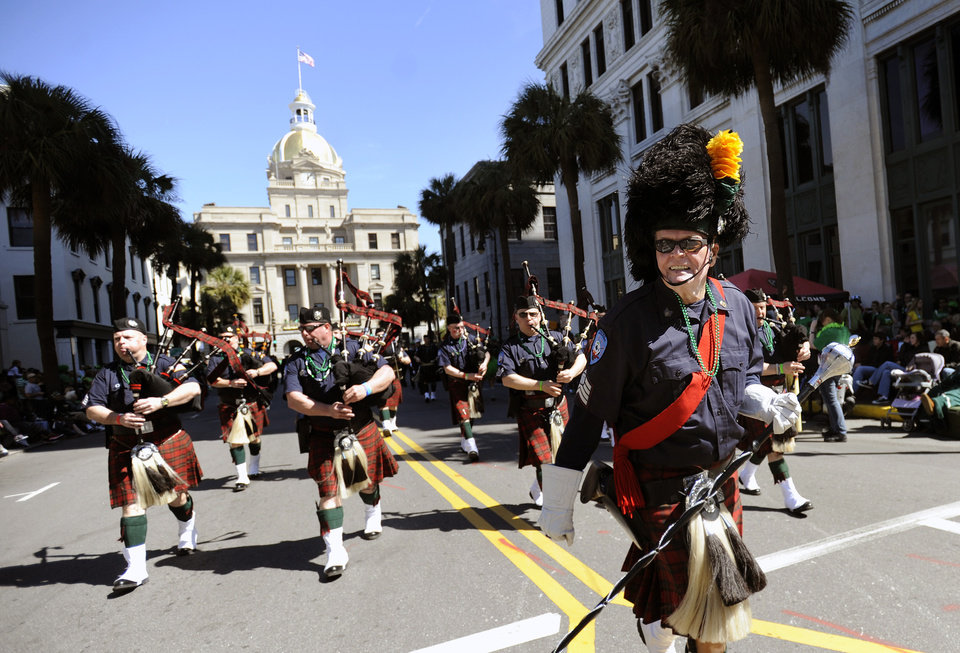 Photo - Doc Foley leads the Yonkers, N.Y., Fire Department Pipe and Drum in Savannah's 189-year-old St. Patrick's Day parade, Saturday, March, 16, 2013, in Savannah, Ga. Started in 1824 by early Irish immigrants to Georgia, the parade has ballooned into a sprawling street party that makes for Savannah's most profitable tourism event. (AP Photo/Stephen Morton)