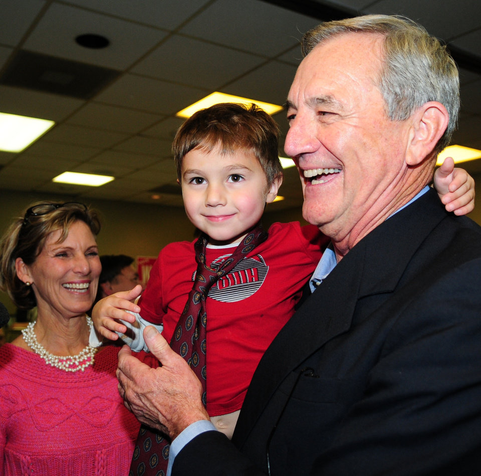 Mary Nolan, left, watches as her husband Rick Nolan hold their grandson Mitchell Nolan, 4, at a DFL gathering at the Brainerd Hotel in Brainerd, Minn., Tuesday, Nov. 6, 2012. Nolan and Chip Cravaack are in a tight battle for the Minnesota 8th Congressional District. (AP Photo/Brainerd Dispatch, Steve Kohls)