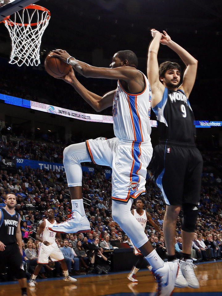 Oklahoma City�s Kevin Durant, left, takes the ball past Minnesota�s Ricky Rubio during Friday�s game at Chesapeake Energy Arena. Photo by Nate Billings, The Oklahoman