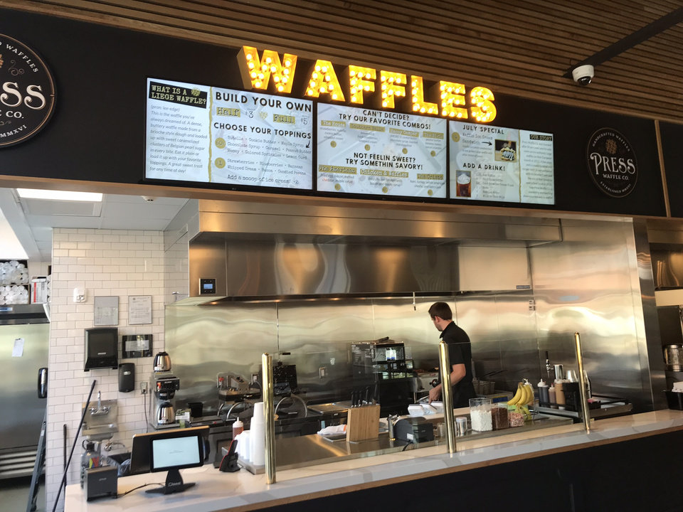 Photo - Press Waffle Co. will be giving away a year's worth of free waffles to five lucky diners at its new location inside The Collective. [Dave Cathey/The Oklahoman]
