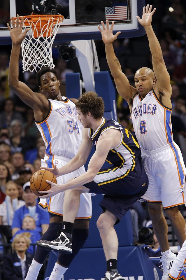 Photo - Oklahoma City Thunder's Hasheem Thabeet (34) and Derek Fisher (6) defend on Utah Jazz's Gordon Hayward (20) during the NBA basketball game between the Oklahoma City Thunder and the Utah Jazz at Chesapeake Energy Arena on Wednesday, March 13, 2013, in Oklahoma City, Okla. Photo by Chris Landsberger, The Oklahoman