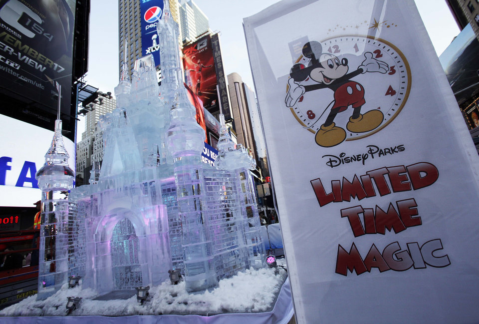 Photo -   A three-story castle made of ice is displayed in New York's Times Square, Wednesday, Oct. 17, 2012. On Wednesday, Disney announced a new program for 2013,