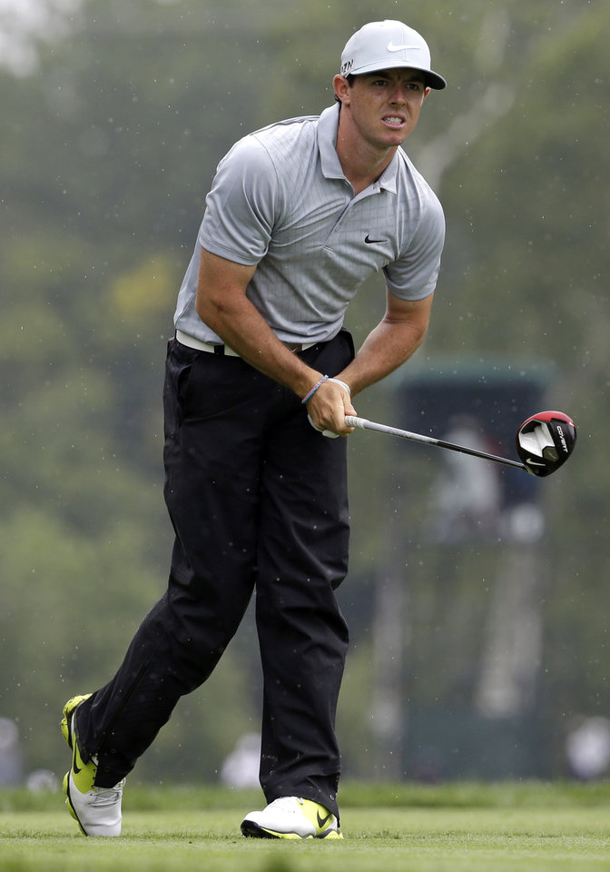 Photo - Rory McIlroy, of Northern Ireland, watches his tee shot on the fifth hole during the second round of the PGA Championship golf tournament at Valhalla Golf Club on Friday, Aug. 8, 2014, in Louisville, Ky. (AP Photo/John Locher)
