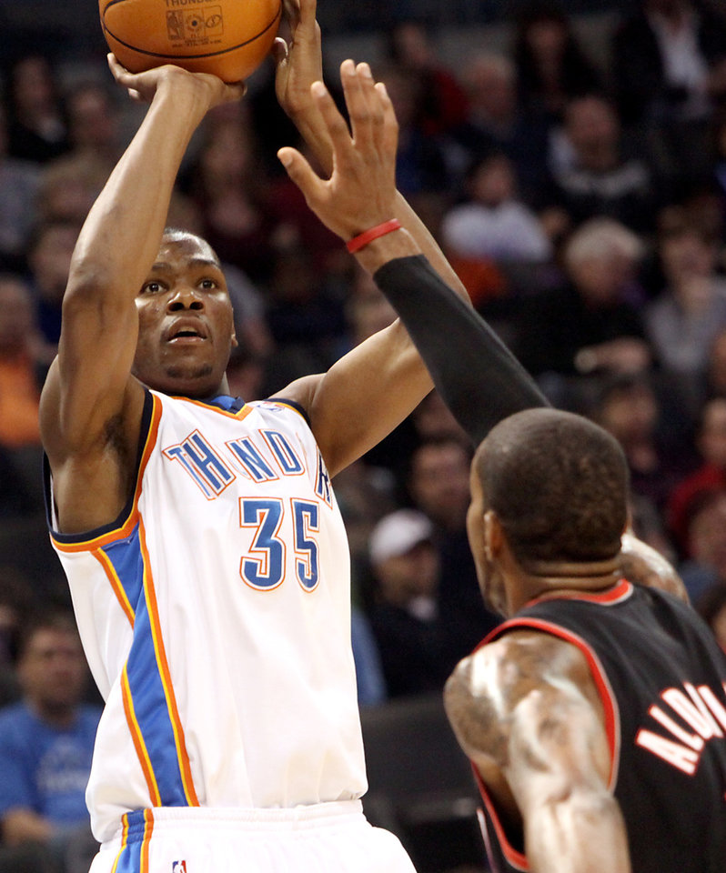 Oklahoma City's Kevin Durant puts up a shot over Portland's LaMarcus Aldridge during their NBA basketball game at the Ford Center in Oklahoma City, Okla., on Sunday, March 28, 2010. Photo by John Clanton, The Oklahoman