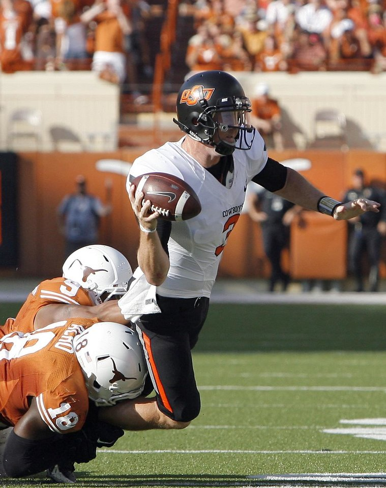 Photo - Texas' Dravannti Johnson (9) and Emmanuel Acho (18) pressure Oklahoma State's Brandon Weeden (3)during second half of a college football game between the Oklahoma State University Cowboys (OSU) and the University of Texas Longhorns (UT) at Darrell K Royal-Texas Memorial Stadium in Austin, Texas, Saturday, Oct. 15, 2011. Photo by Sarah Phipps, The Oklahoman