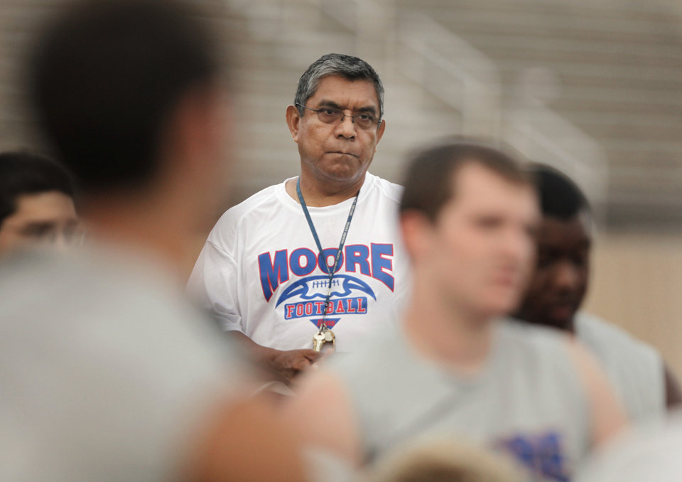 Steve Mancillas works with the Moore High School football team on Thursday, July 1, 2010, in Moore, Okla. He grew up in Woodward and lived with his grandparents, who didn't speak a lick of English. He went to college, got a teaching degree and became a science teacher. He is now in 30-plus years at Moore HS teaching high level science and coaching football. He could probably be somewhere else making lots more money -- his AD said he's the smartest guy he knows -- but he has chosen to stay at Moore teaching and coaching and living his American Dream.  Photo by Steve Sisney, The Oklahoman