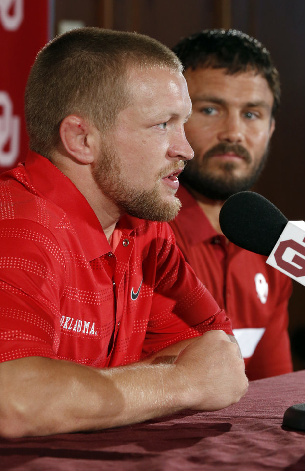 Photo - Sam Hazewinkel (left) speaks during a press conference on Thursday, July 5, 2012 in Norman, Okla. He and fellow wrestler Jared Frayer (right) are among six athletes from the University of Oklahoma who have qualified for the 2012 London Olympics in track and field, wrestling and men's gymnastics  Photo.  Photo by Steve Sisney, The Oklahoman